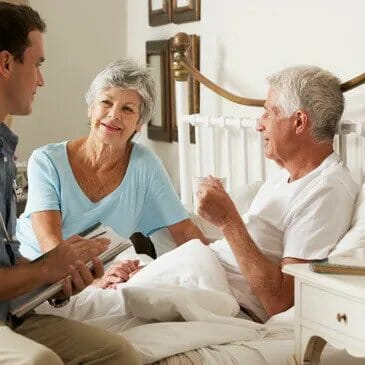 Elderly couple chat to a doctor